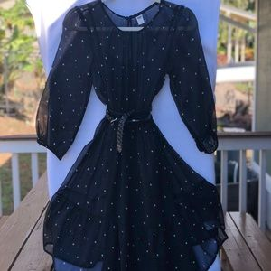 Long sleeve black tulle dress with lining.